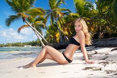 Stock Photo of girl in bikini on caribbean beach