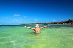 girl in caribbean sea - stock photo