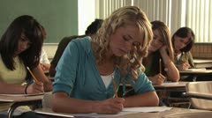 Young woman in a classroom Stock Footage