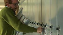 Nerd trying to open locker Stock Footage