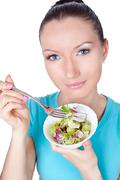 portrait of woman eating vegetarian salad - stock photo
