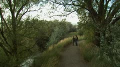 father and son walking down a trail - stock footage