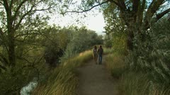couple walking down a trail - stock footage