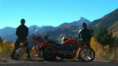 Two motorcyclists making a pit stop Stock Footage