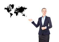 businesswoman showing on world map - stock photo