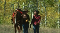 two women with a horse - stock footage
