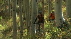 Man and woman on mountain bikes Stock Footage