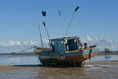 Fishing boat waiting for the tide Stock Photos