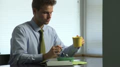 Man eating breakfast before work with tablet Stock Footage