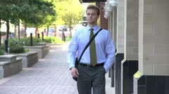 Man on his way to work, entering building - stock footage