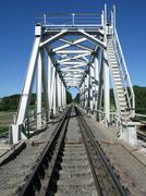 train truck and railroad bridge - stock photo