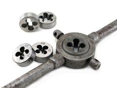 Tap holder and screw threading die Stock Photos