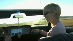 Girl singing while riding in a convertible Stock Footage