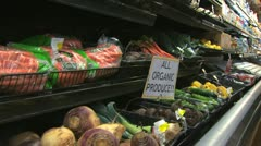 Woman buying organic produce Stock Footage