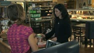 Stock Video Footage of customer offering a reusable bag to a grocery clerk