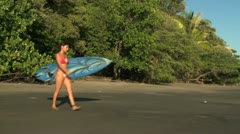 woman going to surf - stock footage