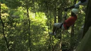 Stock Video Footage of man on a zip line through the trees