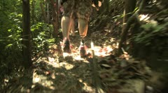Amputee hiking through the jungle Stock Footage
