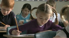 Girl doing class work Stock Footage