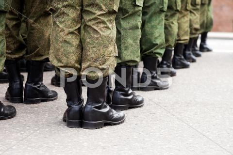 Stock photo of military uniform soldier row