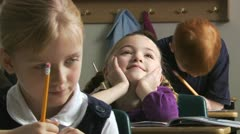Girl daydreaming in class Stock Footage