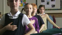 Students reciting the pledge of allegiance Stock Footage