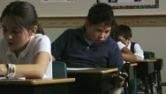 Stock Video Footage of student using a cell phone to cheat