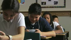 Student using an mp3 player in class Stock Footage