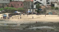 Outfielder splashes through low tide during baseball game on Casco Viejo beach Stock Footage