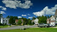 Stock Video Footage of Time lapse of idyllic suburbs with homes on a cul de sac and rolling cumulus clo