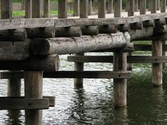 wood bridge on water - stock photo