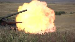 Military, slo-mo (true slow motion 480 FPs) leopard 2A4 tank firing main gun Stock Footage
