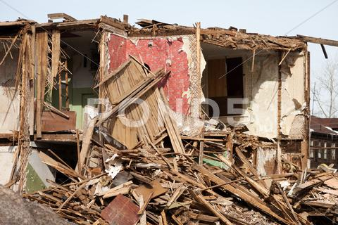 Stock photo of disaster ruined house