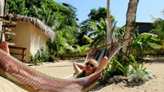 Relaxing in Hammock Stock Footage