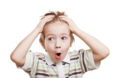 Amazed or surprised child boy Stock Photos