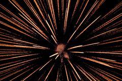 Exploding pyrotechnic firework sparks on night sky Stock Photos
