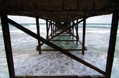 Under the pier. Stock Photos