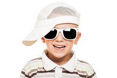 smiling child boy in sunglasses - stock photo