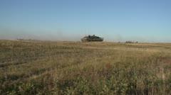 Military, Leopard 2A4 tank on the move follow shot, machine gun fire Stock Footage