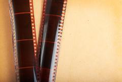 Retro photo album background with filmstrip Stock Photos