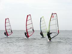 four windsurfers - stock photo