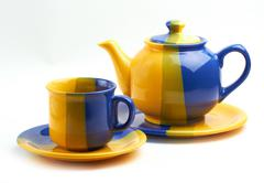 teapot and cup on white - stock photo