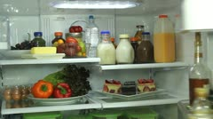 Man Opens Refrigerator Chooses Healthy Beverage   - stock footage