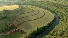 Aerial view of the river, agricultural area with forest Stock Footage
