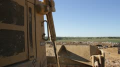 Stock Footage - HD1080p - Pollution - Landfill - Bull Dozer - Waste Stock Footage