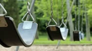 Stock Video Footage of Empty swings swaying at playground