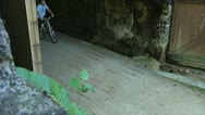 Stock Video Footage of Bike rider leaving tunnel