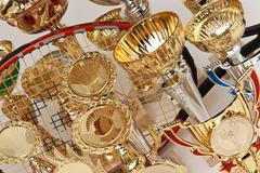 Many sports awards and  tennis racket Stock Photos