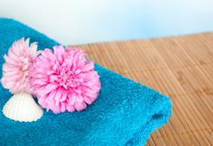 Flowers and towel Stock Photos