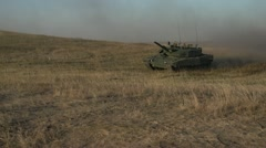 Military, Leopard 2A4tank on the move through frame Stock Footage
